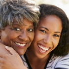 African American Mother and Daughter laughing Outdoors