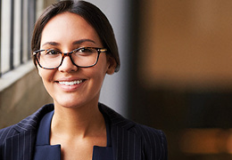 Smiling Hispanic Woman with Glasses